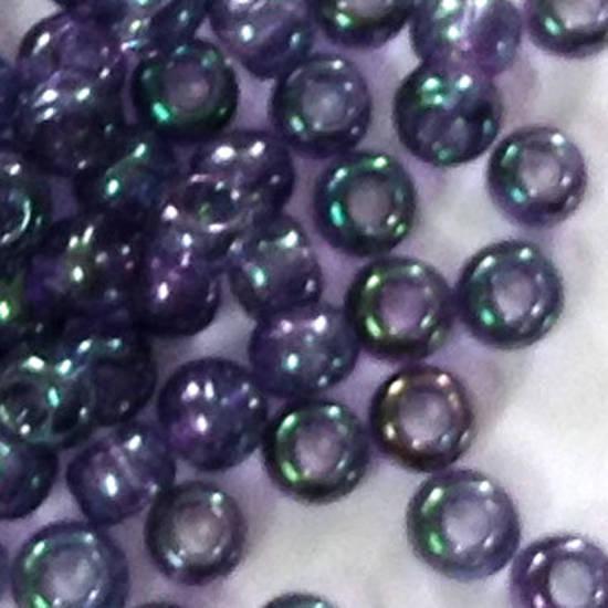 Toho size 11 round: 319C - Purple/Teal Green Iris, transparent