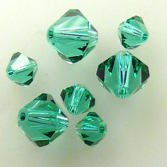 6mm Swarovski Crystal Bicone, Emerald, light