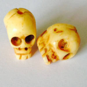 Bone Bead: Bone skull 16mm x 11mm