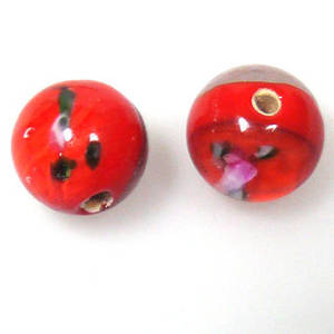 Indian Lampwork, round, orangy red core, transparent sides, floral design inside