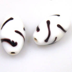 Indian Lampwork, oval, opaque white with black markings