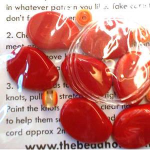 KITSET: Stretch bracelet, large acrylic red beads with small striped orange beads