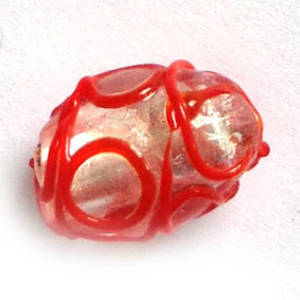 Chinese Lampwork Oval, transparent with silver foil core and red swirls