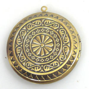 Large brass coloured medallion locket
