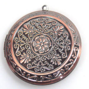 Large copper coloured medallion locket