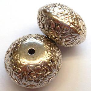 Metalised plastic, large fat rhondelle bead with flower imprint