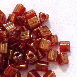 Miyuki size 10 triangle: 319T - Red/Gold, transluscent