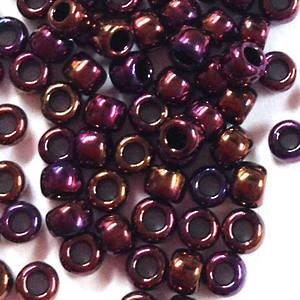 Toho size 8 round: 460A - Purple/Copper