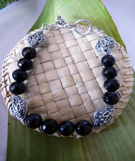 Facet cut black onyx beads and silver bracelet