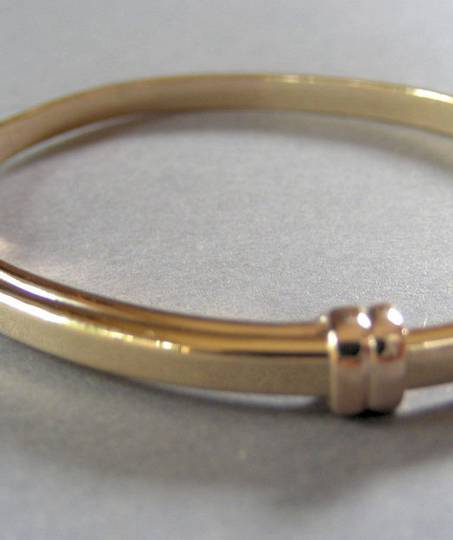 Made to order solid gold baby bangle