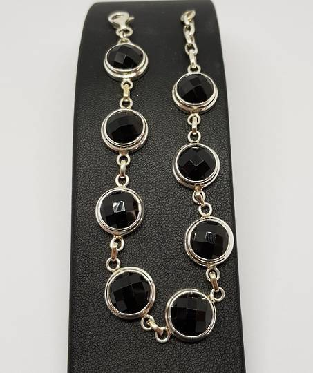 Facet cut black onyx sterling silver bracelet
