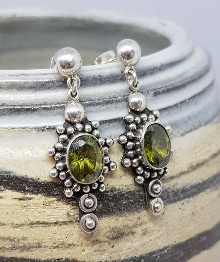 Large ornate silver peridot earrings, stud style