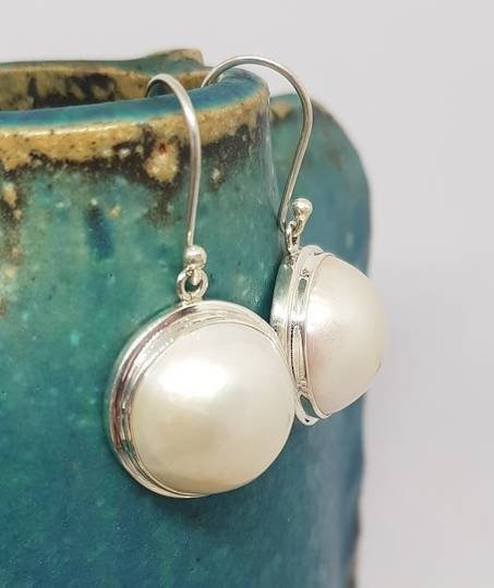 Large white mabe pearl earrings