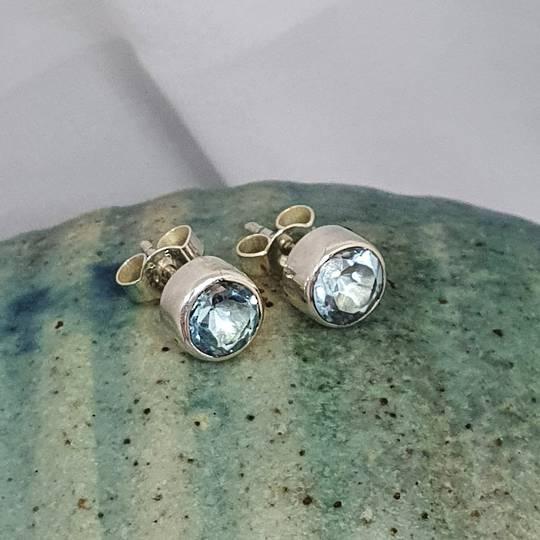 Round blue topaz stud earrings