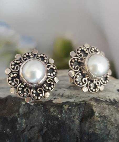 White pearl stud earrings with filigree silver frames