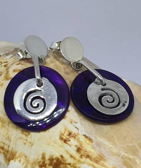 Purple paua shell earrings with koru detail