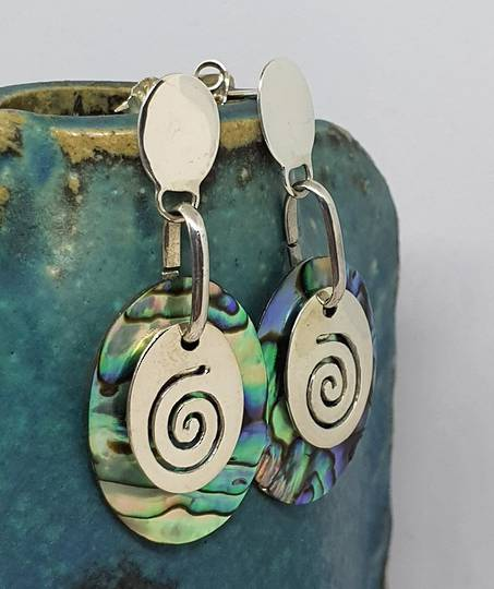 Silver paua shell earrings with silver koru disc