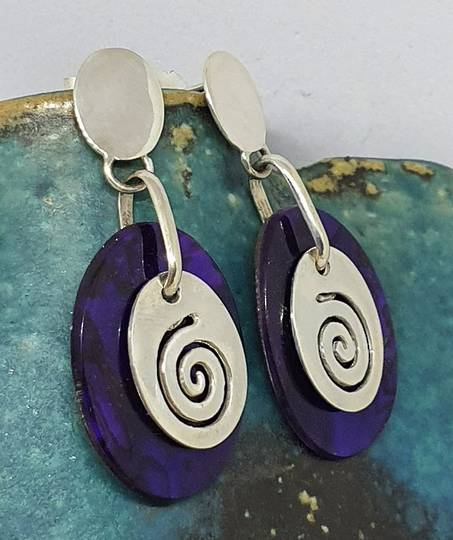 Purple paua shell earrings with silver koru disc