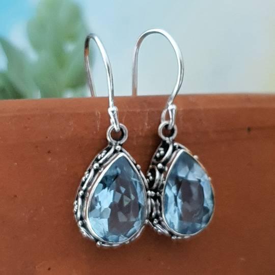 Dazzling blue topaz teardrop silver hook earrings