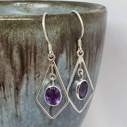 Silver hook earrings with oval purple gemstone
