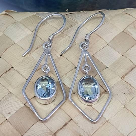 Silver hook earrings with oval blue topaz gemstone