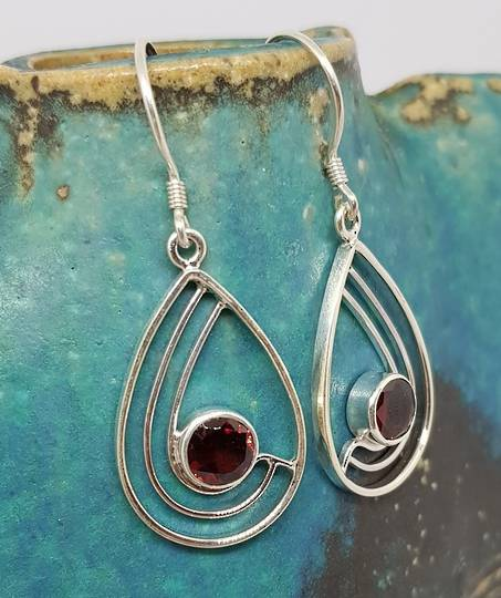 Sterling silver teardrop shaped earrings with garnet
