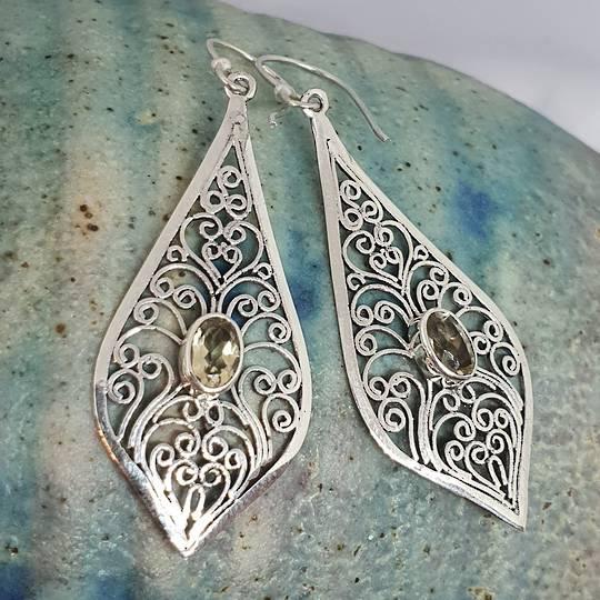 Silver filigree earrings with golden gemstone