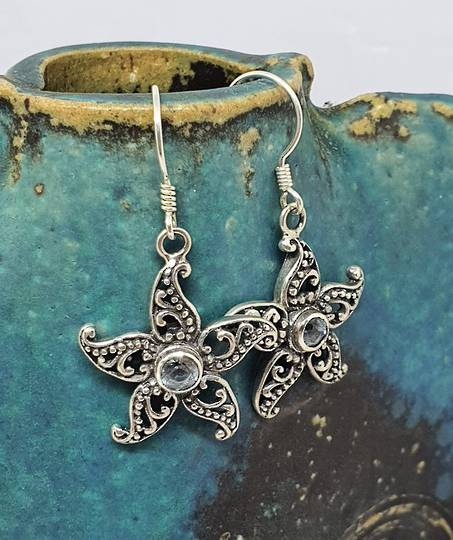 Sterling silver blue topaz flower earrings