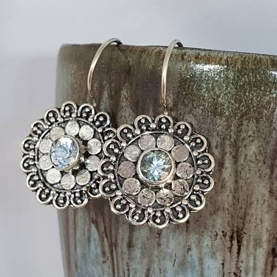 Silver blue topaz flower earrings