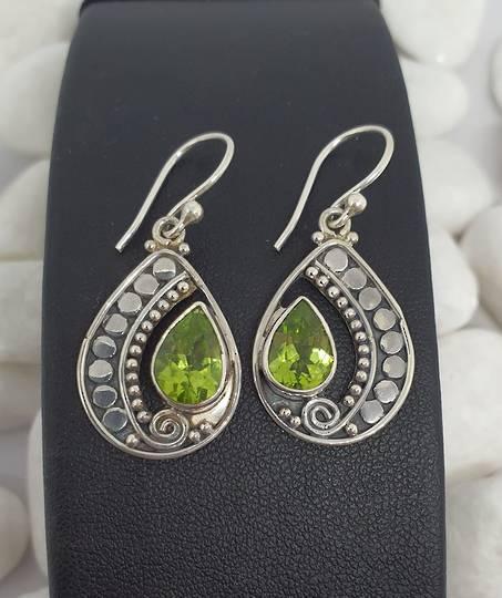 Silver peridot earrings in open teardrop shape