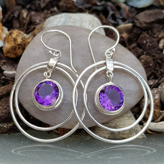 Silver hoop earrings with purple gemstone