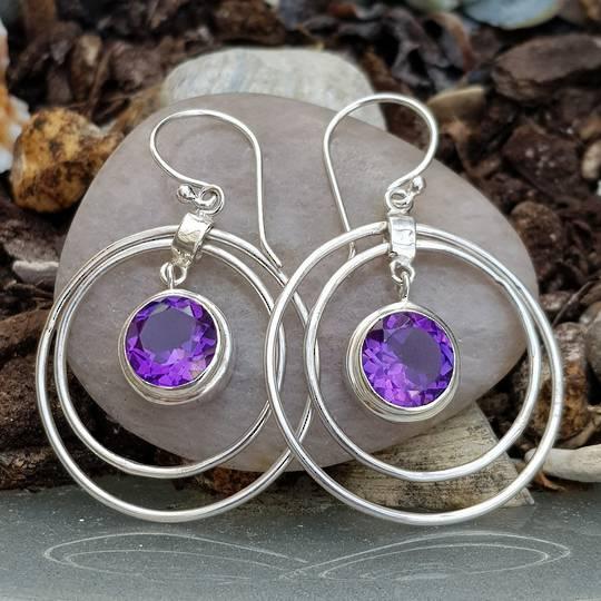 Silver hoop earrings with purple gemstone