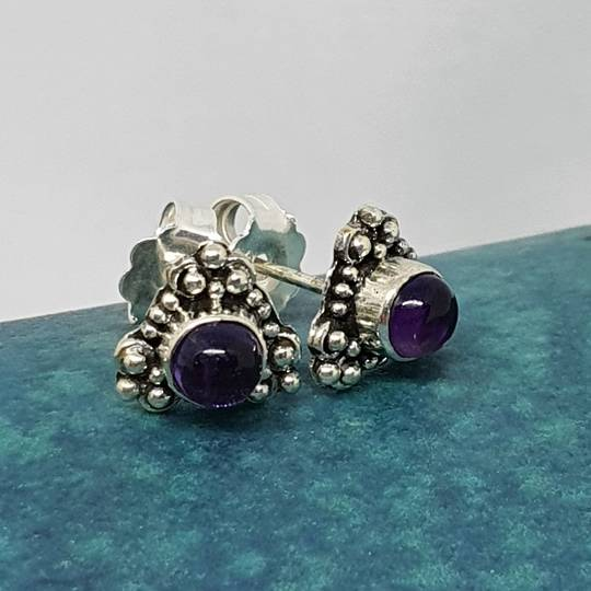 Silver stud earrings with natural amethyst