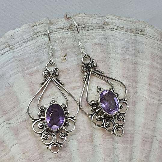 Silver filigree earrings with purple gemstone