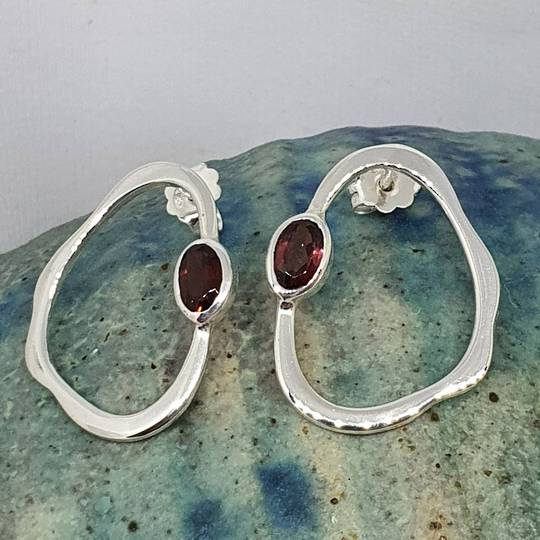 Open wonky oval shape garnet earrings