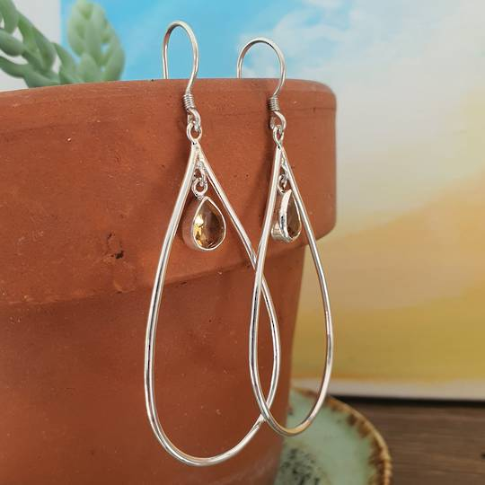 Oval silver hook earrings with citrine