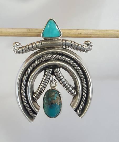 Unusual medallion turquoise silver pendant