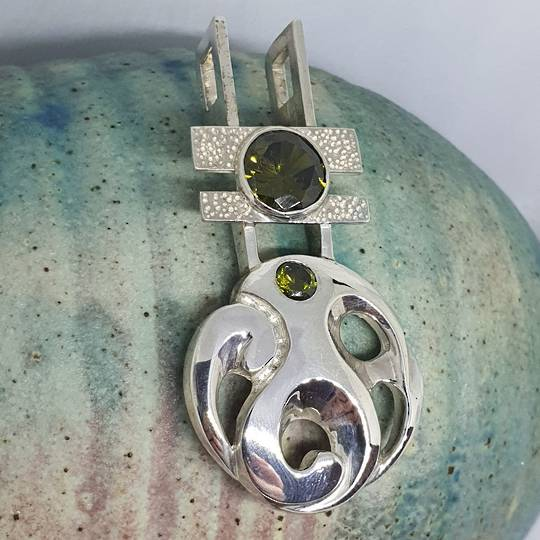 Made in NZ silver koru inspired pendant
