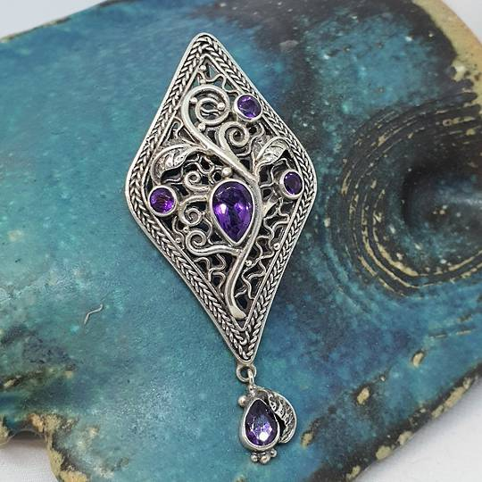 Exquisite detailing in this silver amethyst pendant that is also a brooch