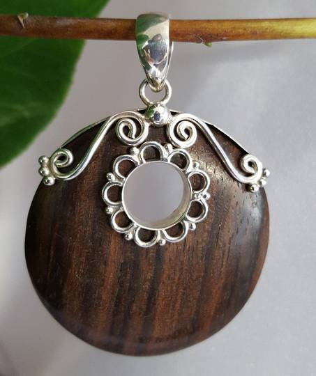 Polished wooden pendant with silver detailing - now on sale