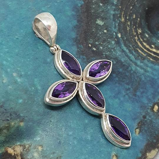 Sterling silver cross pendant with purple gemstones