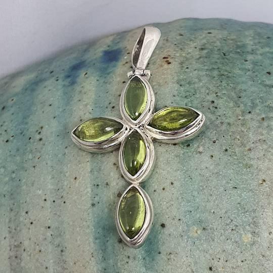 Cabochon cut peridot, silver cross pendant
