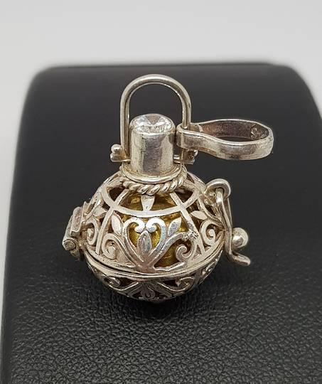 Delightful silver harmony ball pendant