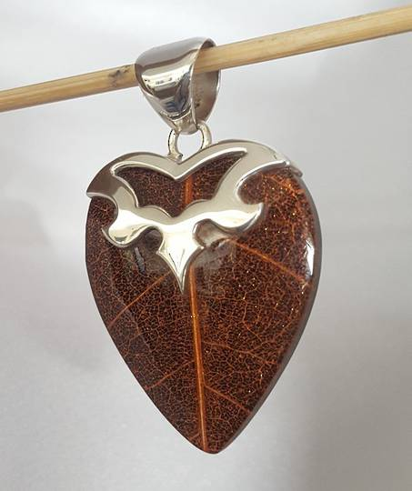 Heart shaped brown skeleton leaf pendant
