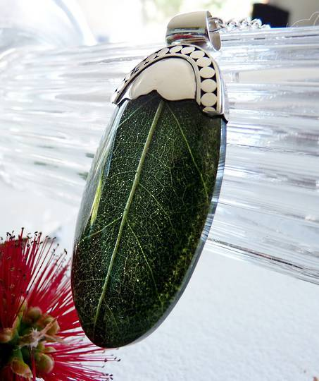 Green skeleton leaf pendant set in sterling silver