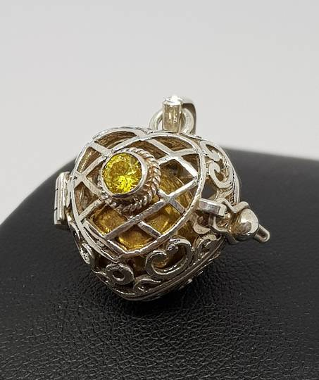 Sterling silver filigree meditation ball pendant