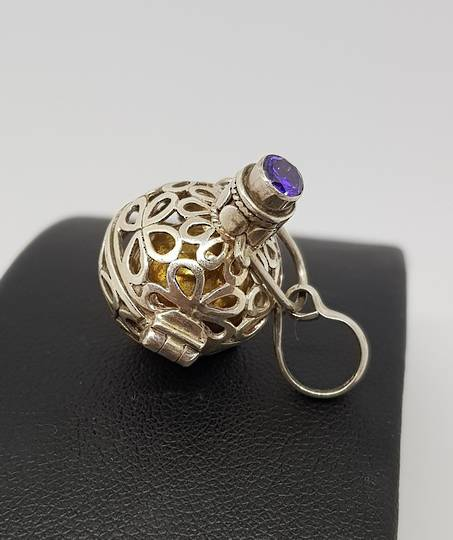 Silver meditation ball pendant with facet cut amethyst