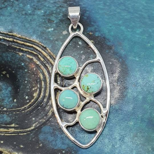 Sterling silver eloganted oval turquoise pendant