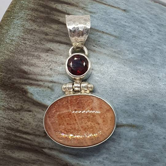Sterling silver sunstone and garnet pendant
