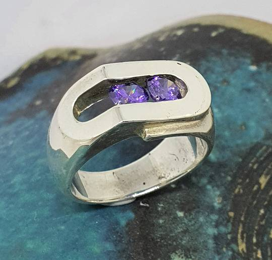 Chunky sterling silver ring with sparkling purple gemstones